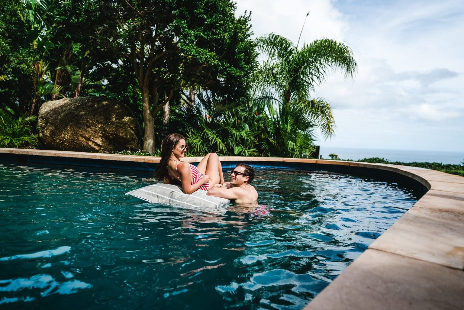 A couple enjoys the pool at 21 Nettleton