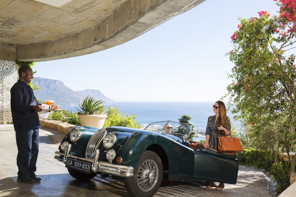 A guest arrives at 21 Nettleton in a classic car