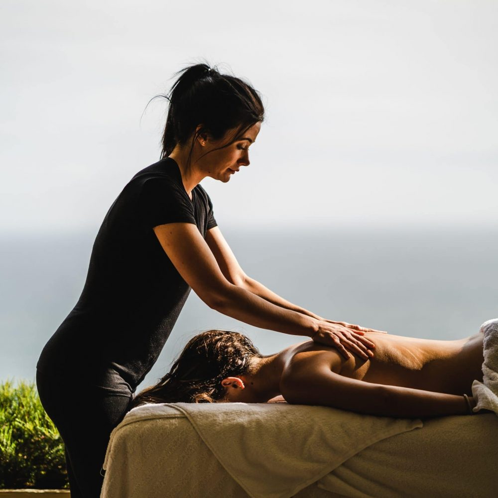 A guest enjoying a massage at 21 Nettleton
